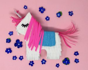 winnie unicorn pinata gift box on pink background